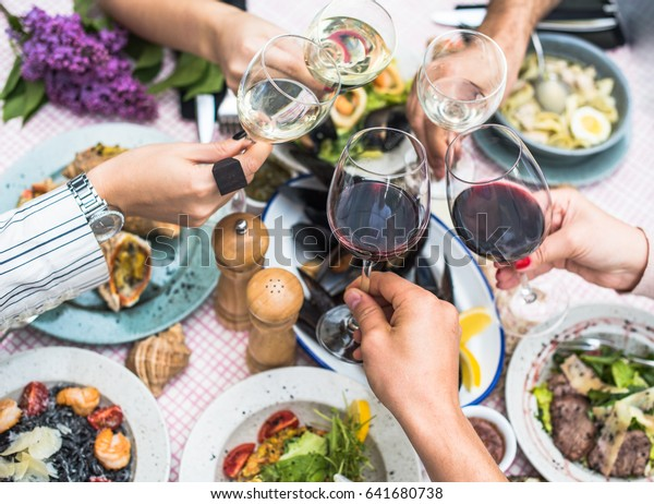 Food Table Healthy Delicious Organic Meal Concept. Enjoying dinner with friends. Top view of group of people having dinner together while sitting at the rustic wooden table