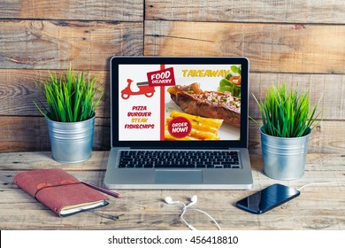 Food take away website in a laptop screen. Lunch at the office.