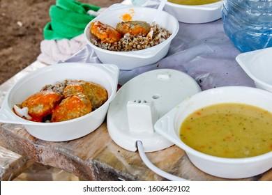 Food at the tent camp: buckwheat porridge, chop, soup.