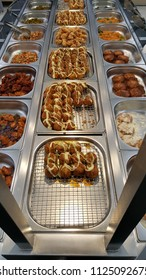 Food tray in supermaket with fried food and takoyaki bar