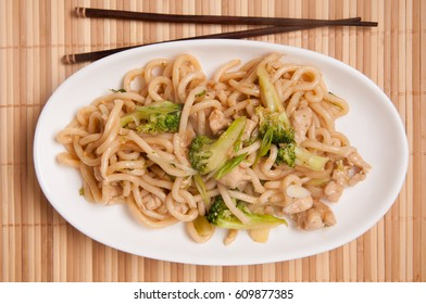 food truck asian style stir fried chicken with udon noodle and broccoli