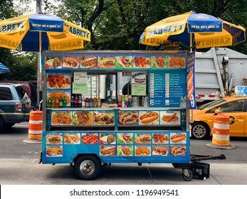 Food Trucks vendors in New York City. Popular NYC food truck for residents and tourists. From Hot dog to fresh juice food. Street food vendors in Manhattan. New York. USA. 10/03/2018