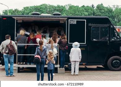 food van truck. group of people customers at mobile van with burgers and bbq at street food festival. food truck with snacks and drinks at eating market