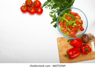 Food. Vegetables. Vegetables cut on a wooden board. We cut lettuce. Vegetable salad for vegetarians. Isolated. On a white background. Interior decoration. Delicious salad. Sliced vegetables. Close-up.