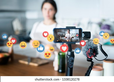Food vlogger recording a video - Shutterstock ID 1338120278
