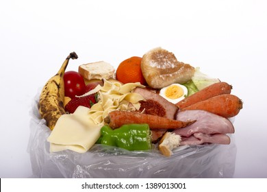 food wastage, vegetables and fruits in a garbage bag