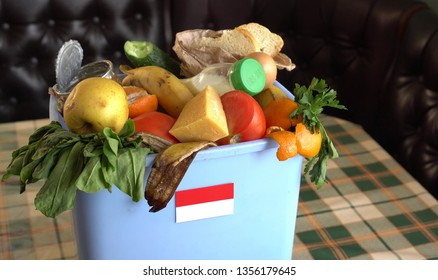 Food waste in Trash Bin. The problem of food waste in Indonesia. Recycling, Trash, Donating and Composting