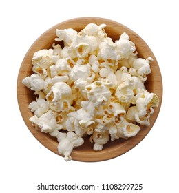 Food: wooden bowl full of popcorn, isolated on white background