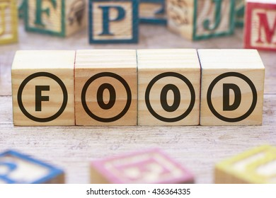 Food word written on wood cube
