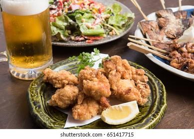 Foods and draft beer at Izakaya, Japanese pub