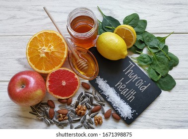 Foods for healthy thyroid. Variety of natural healing foods that nourish the thyroid gland. Assortment of natural products to boost thyroid health. Concept of healthy eating for a healthy thyroid.