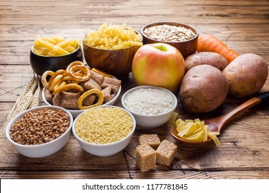 Foods high in carbohydrate on rustic wooden background