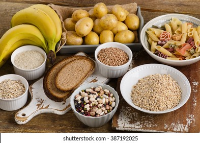Foods high in carbohydrate on a wooden background. Top view