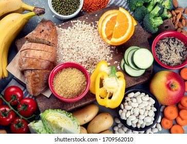 Foods high in carbohydrates on grey background. Vegan Foods high in dietary fiber, antioxidants, vitamins and minerals. Top view