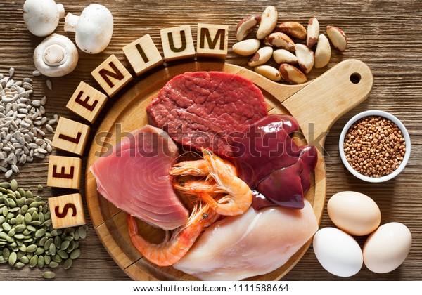 Foods High in Selenium as brasil nuts, tuna, shrimps, beef, liver, chicken meat, mushrooms, pumpkin seeds, sunflower seeds, buckwheat and eggs. Top view