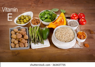 Foods high in vitamin E on a wooden table. Top view