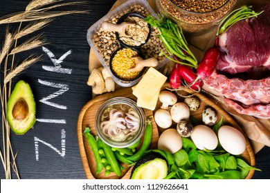 Foods High in Zinc as octopus, beef, buckwheat, yellow cheese, spinach, avokado,pea, mushrooms, bean, radishes, eggs. Top view