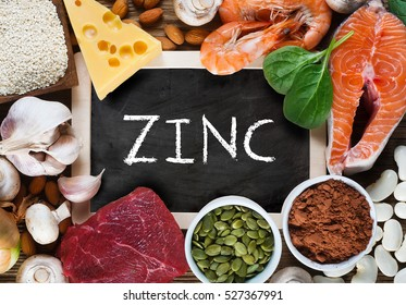 Foods High in Zinc as salmon, seafood-shrimps, beef, yellow cheese, spinach, mushrooms, cocoa, pumpkin seeds, garlic, sesame, bean and almonds. Top view