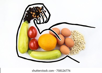 Foods to increase male hormone testosterone and increase virility and biceps. Products for men's health on a white background with space for text