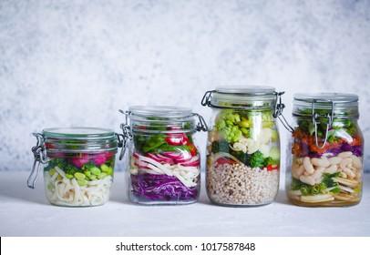 Foods in a jar. Vegan salad in jar healthy keto dieting food variety vegan salads