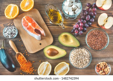 Foods providing low cholesterol diet on the wooden background