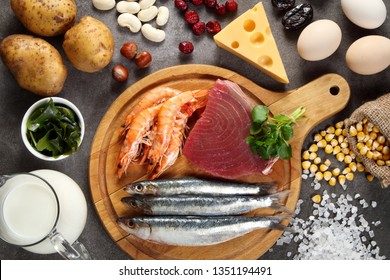 Foods rich in iodine on grey background