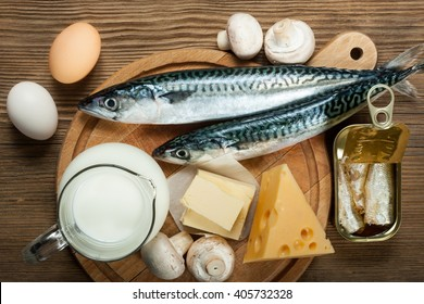 Foods rich in natural vitamin D as fish, eggs, cheese, milk, butter, mushrooms, canned sardines