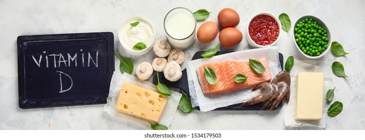 Foods rich in vitamin D for healthy bones, healthy infants and pregnancy. For Cancer, flu and diabet prevention. Top view, flat lay. Panorama, banner