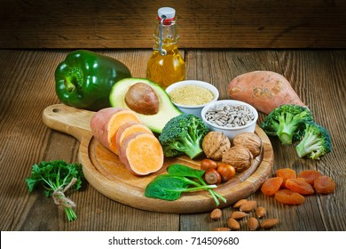 Foods rich in vitamin E such as wheat germ oil, dried wheat germ, dried apricots, hazelnut, almonds, parsley leaves, avocado, walnuts, sweet potato, broccolii, sunflower seeds, spinach, green paprika