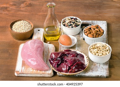 Foods with Selenium  on rustic wooden board.