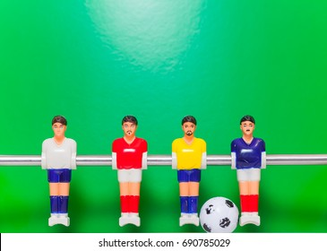 Foosball table players team on a green background