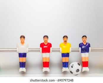 Foosball table players team on a silver background