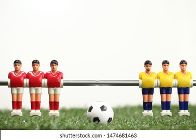 foosball table soccer . sport team football red yellow players