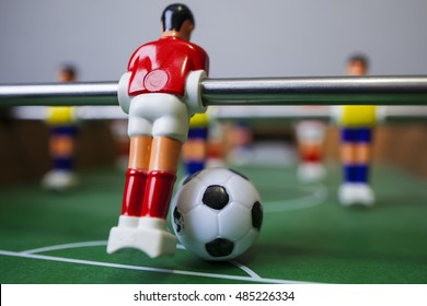 Foosball table soccer .sport team football players