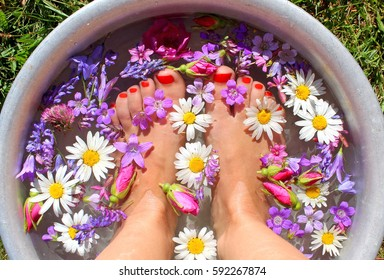 Foot bath with flowers.