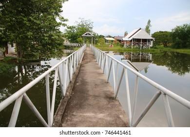 Foot bridge across a narrow canal