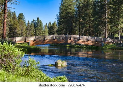 Foot bridge crossing over Spring Creek at Collier Memorial State Park in Chiloquin, Oregon