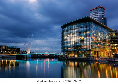 Foot bridge linking BBC media city and Imperial War museum at the Salford Quays, Manchester.