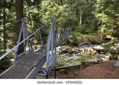 Foot bridge with metal grid on the floor