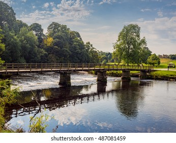Foot bridge over the river Wharfe, Bolton Abbey, Skipton, Yorkshire, UK