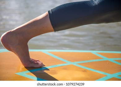 Foot and calf Isolated doing SUP yoga