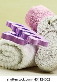 Foot care. Pedicure accessories set tools : pumice with footprint, towel, toe separators closeup