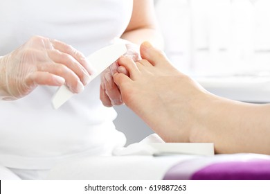 Foot care, pedicure. Woman in a beautician at a pedicure