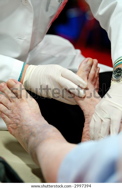 Foot exam of patient with diabetes