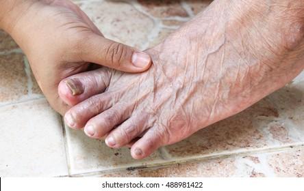 foot in hand , foot screening test, diabetes health promotion