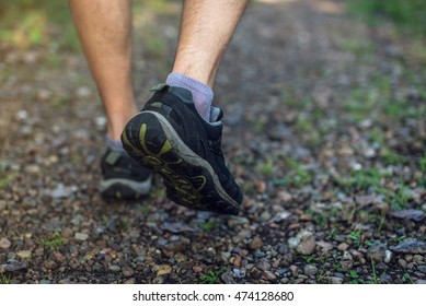 Foot of jogging person in sneakers. close up