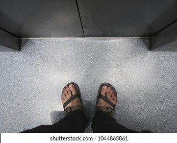 Foot of a man with the door of elevator lift