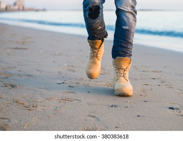 Foot man walking outdoor on beach trendy style
