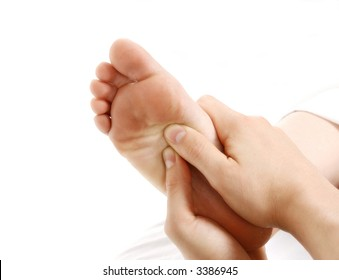 a foot massage given by a therapist in a spa