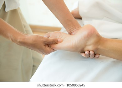 Foot massage with oil, Thai foot massage alternative medicine therapy with Thai herb aroma oil, Background for spa or alternative medical therapy concept.Relaxing massage on the foot in spa salon.